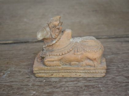 antique nandi bull carved in wood
